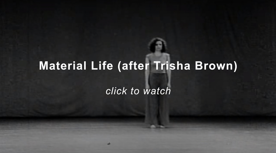 A woman standing on a stage. A black and white film still from Trisha Brown's Water Motor solo. Click the image to play the slideshow.